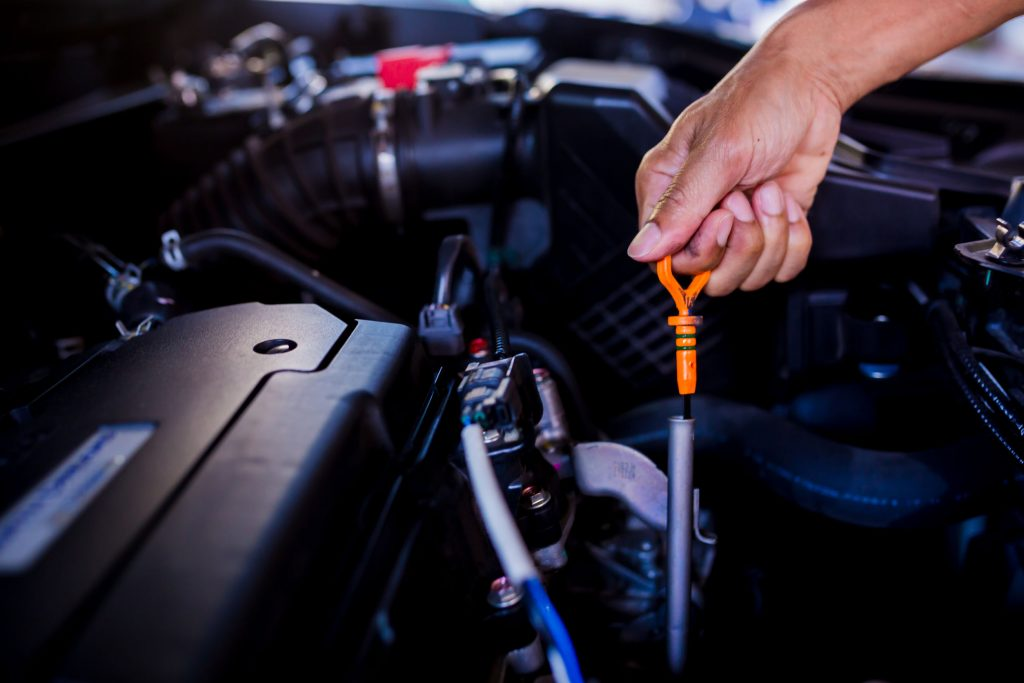 Check the oil level in car engine. Mechanic checking car engine or vehicle. Check and maintenance car with yourself. Service and maintenance vehicle.